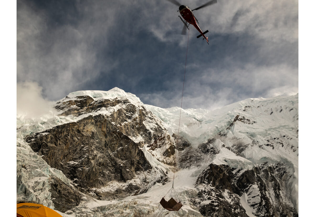 The helicopter approaching the base camp at an altitude of 5000 metres.