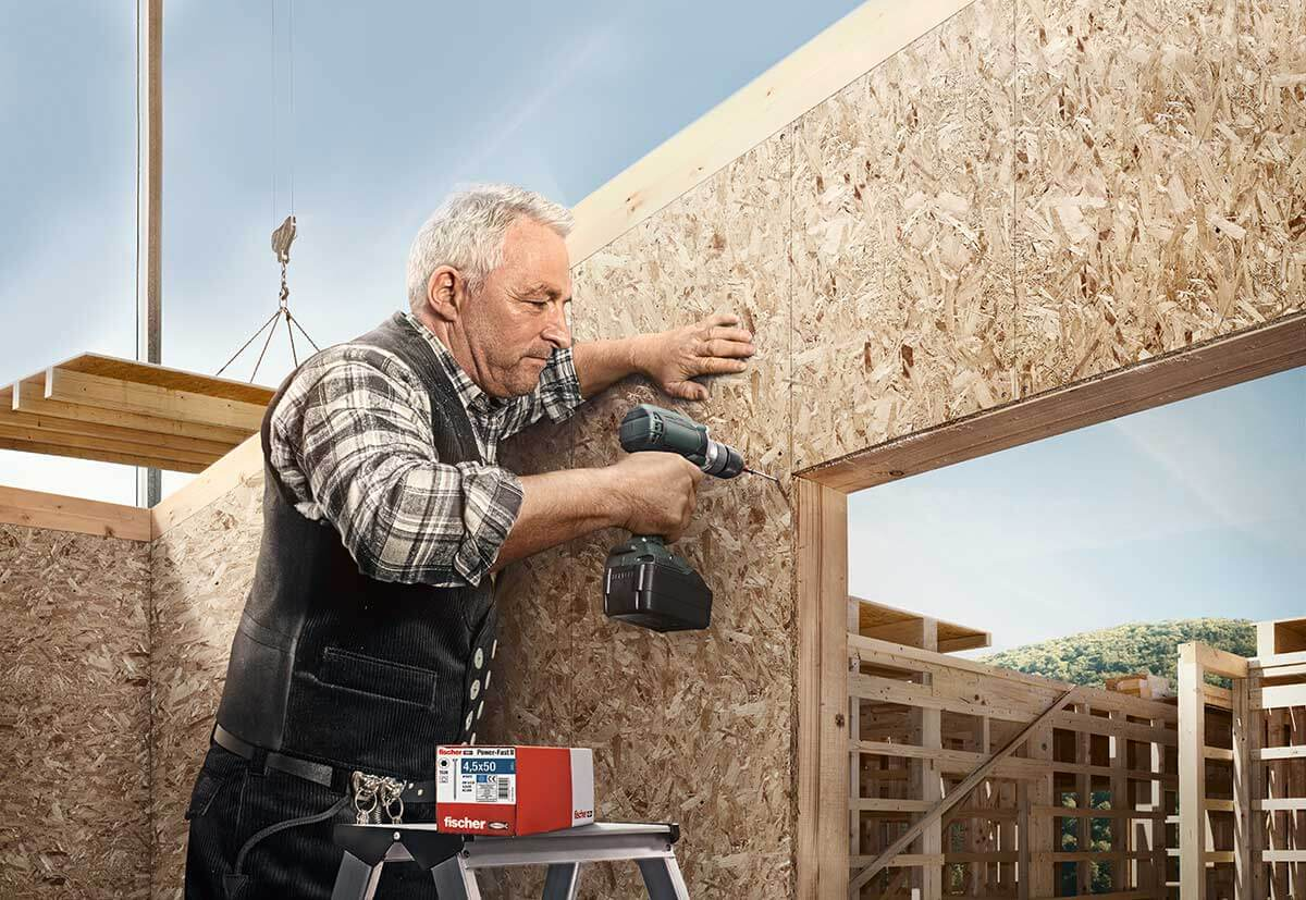 Carpenters screwing together chipboard